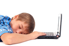 Kid in front of laptop stock photo