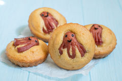 Kid funny food. Cornbread muffins with sausage octopus Stock Image
