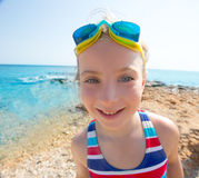 Kid funny girl wide angle beach portrait swimsuit and goggles Royalty Free Stock Photos