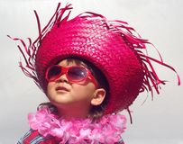 Kid with funny tropical hat Stock Image