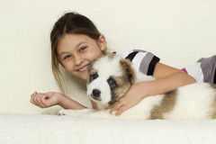 Kid gently hugging a puppy Royalty Free Stock Photo
