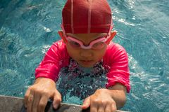 Kid get ready to swimming. In swimming class, swimming pool, summer Stock Photos