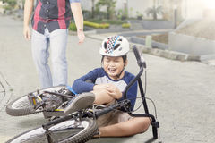 Kid gets accident with his bike and crying Royalty Free Stock Image