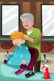 Kid getting a haircut Royalty Free Stock Image