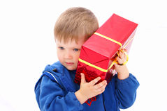 Kid with a gift Royalty Free Stock Photos