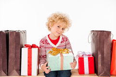 Kid with gift boxes and shopping bags Royalty Free Stock Photos
