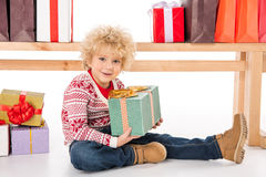 Kid with gift boxes and shopping bags Stock Photography