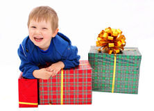 Kid with a gifts Stock Photos