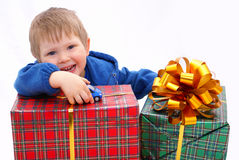 Kid with a gifts Royalty Free Stock Photos