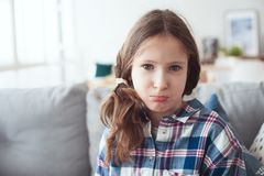 Kid girl asking parents to buy toys or gifts, or saying sorry. For being naughty royalty free stock image