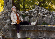 Kid girl in autumn park Stock Images