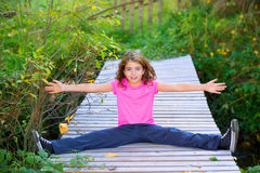 Kid girl in autumn smiling with braces open arms and legs Royalty Free Stock Image