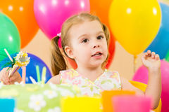 Kid girl with balloons and cake on birthday Royalty Free Stock Photography