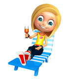 Kid girl with  Beach chair and juice glass Stock Photography