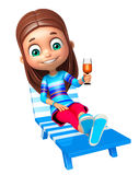 Kid girl with  Beach chair and juice glass Stock Photo