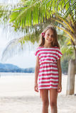 Kid girl on the beach royalty free stock image