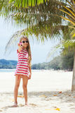 Kid girl on the beach. 8 years old girl resting on the tropical palm beach in Thailand in summer Stock Image