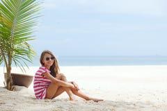 Kid girl on the beach Stock Photos