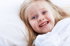 Kid girl in bed . Stock Photos
