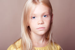 Kid girl on beige Royalty Free Stock Photography