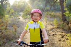 Kid girl biker in mountain bike MTB Stock Image