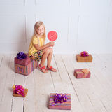 Kid girl with birthday presents Stock Photography