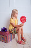 Kid girl with birthday presents Royalty Free Stock Images