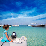 Kid girl in boat at formentera Estany des Peix Stock Images