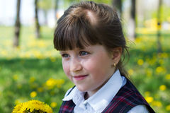 Kid girl with a bouquet of dandelions Stock Images
