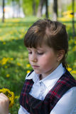 Kid girl with a bouquet of dandelions Royalty Free Stock Image