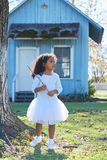 Kid girl with branch stick playing outdoor Royalty Free Stock Images