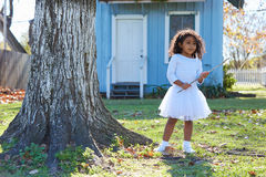 Kid girl with branch stick playing outdoor Stock Photo