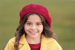 Kid girl bright hat beret long curly hair. Fall hat fashion accessory. French trend fall season. Charming french style. Fashionable girl. Fall fashion concept royalty free stock image