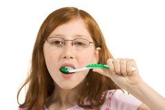 Kid girl brushing Clean teeth. Girl brushing her teeth with toothbrush royalty free stock photography