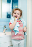 Kid girl brushing teeth in bathroom Royalty Free Stock Photography