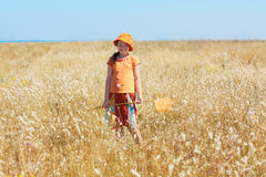 Kid girl with butterfly net on the field Royalty Free Stock Images