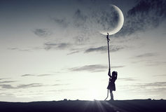 Kid girl catching moon Royalty Free Stock Photos