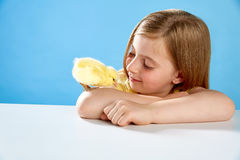 Kid girl with chicks playing on blue Stock Photography