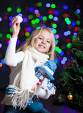 Kid girl at Christmas tree Royalty Free Stock Images