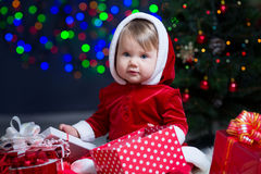 Kid girl at Christmas tree with gifts Royalty Free Stock Images