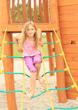 Kid - girl climbing on net ladder Royalty Free Stock Photography