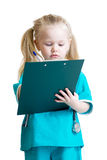 Kid girl in costume of doctor takes notes isolated Royalty Free Stock Photography