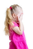 Kid girl cover her face with her hand isolated Royalty Free Stock Photography