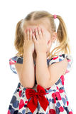 Kid crying or playing with hiding face isolated. Kid girl crying or playing  with hiding face isolated Royalty Free Stock Photo