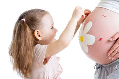 Kid Girl Decorating Pregnant Mother S Belly Stock Photo