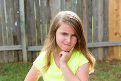 Kid girl with disappoint expression finger thinking Stock Photography