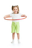 Kid girl does gymnastic with hoop on white Royalty Free Stock Photo