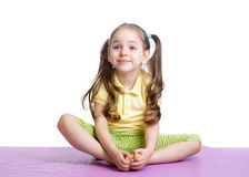 Kid girl doing fitness exercises Royalty Free Stock Photo