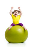 Kid girl doing gymnastics with ball over white background stock photos