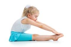 Kid girl doing gymnastics. Kid girl doing fitness exercises royalty free stock image